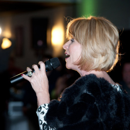 Picture of Woman Singing at Corporate Event