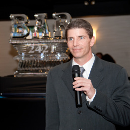 Man Speaking at Grand Opening Event