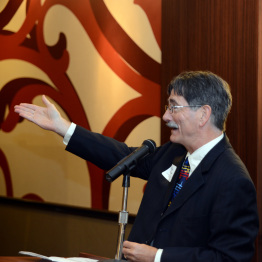 Man Speaking at Awards Dinner Event
