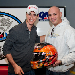 Joey Logano with Artist recieving Helmet for Charity Photo Taken by Wallfrog Corporat Photographer