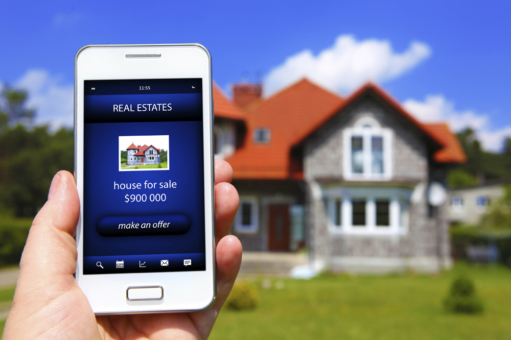 Real Estate MLS Listing on Mobile Phone from Photographer